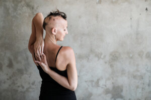 lady with alopecia doing yoga pose